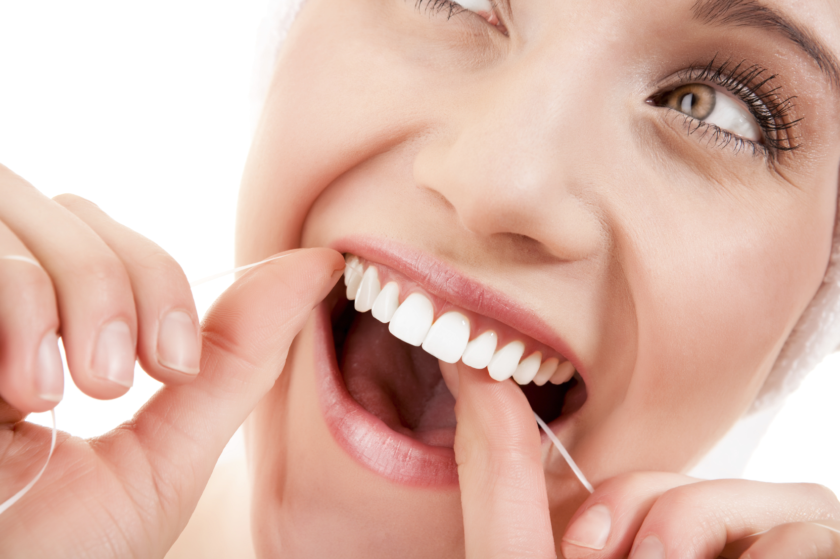 woman-flossing-close-up-oral-health