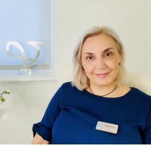 Dr. Maria Minou